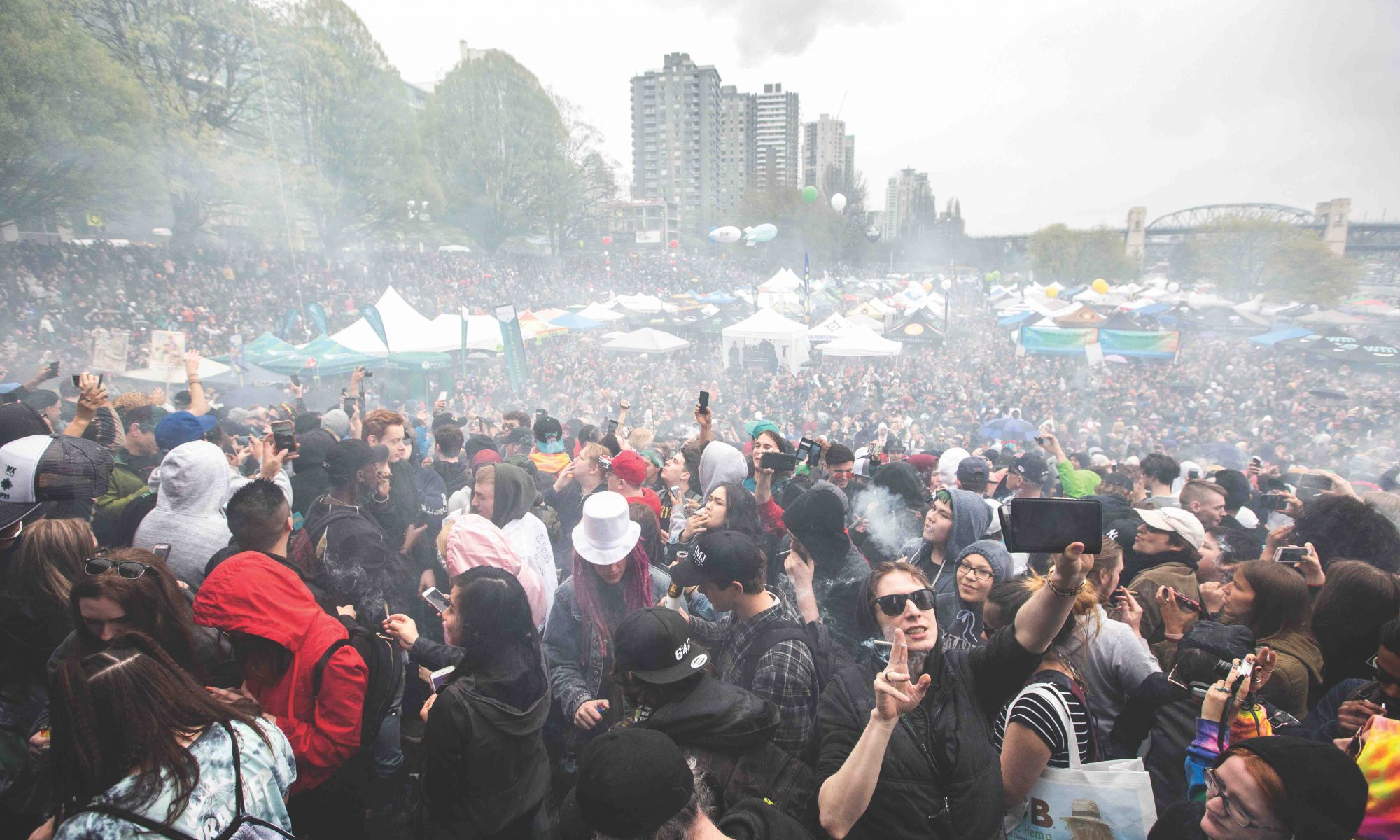 Marijuana users light up in unison at 4:20 p.m. on April 20, 2018 in Vancouver's Sunset Beach Park. Organizers say the annual 420 demonstration will continue despite the federal government commitment to legalize cannabis later this summer. Photo by Jesse Winter/StarMetro Toronto Star